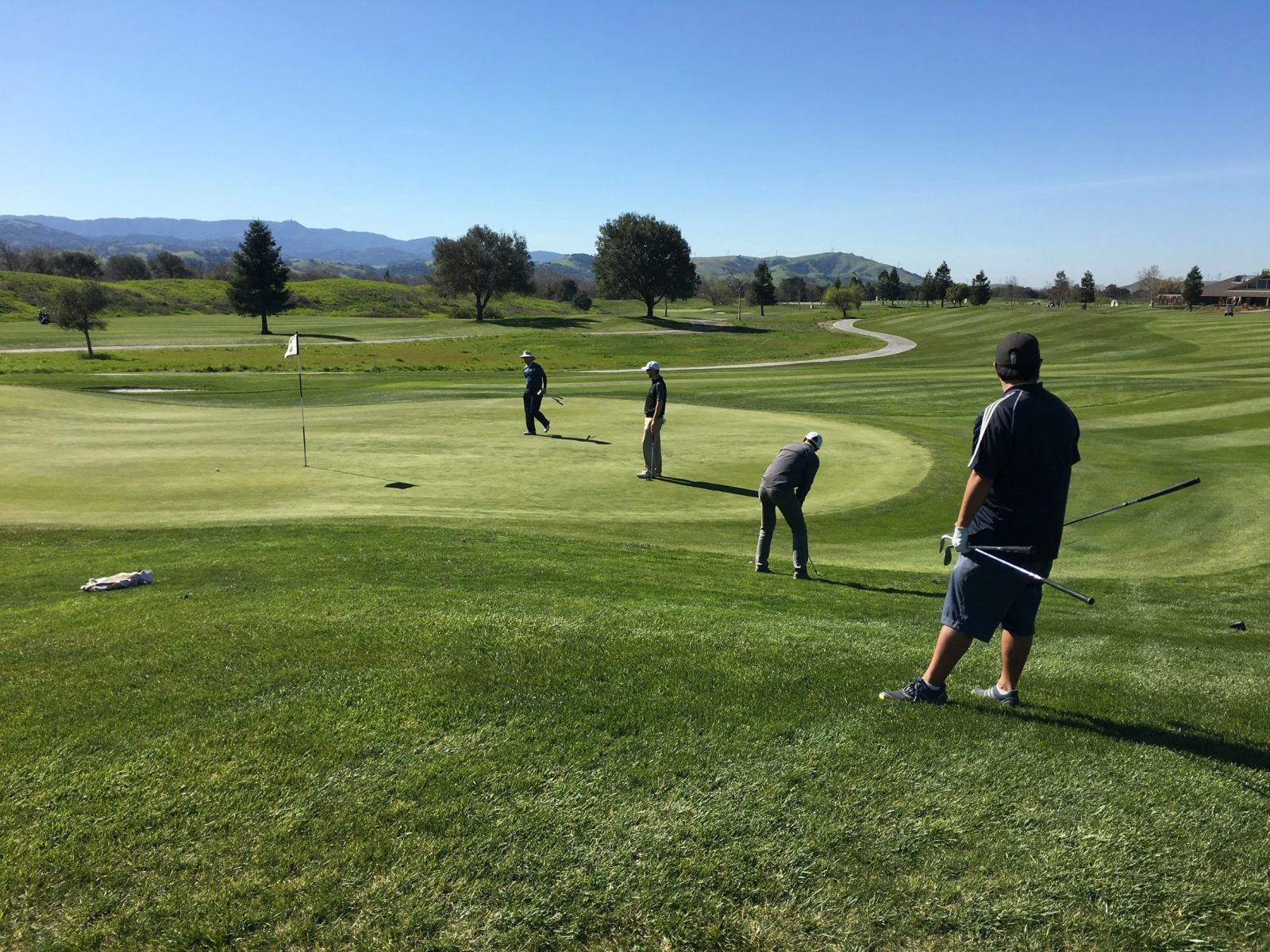 practice green at coyote creek golf club